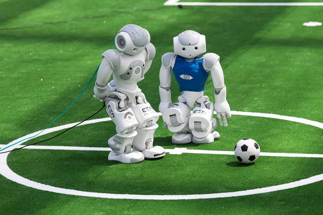 Robots fight for the ball during their football match in the standard platform league tournament at the RoboCup 2017 in Nagoya, Aichi prefecture on July 30, 2017