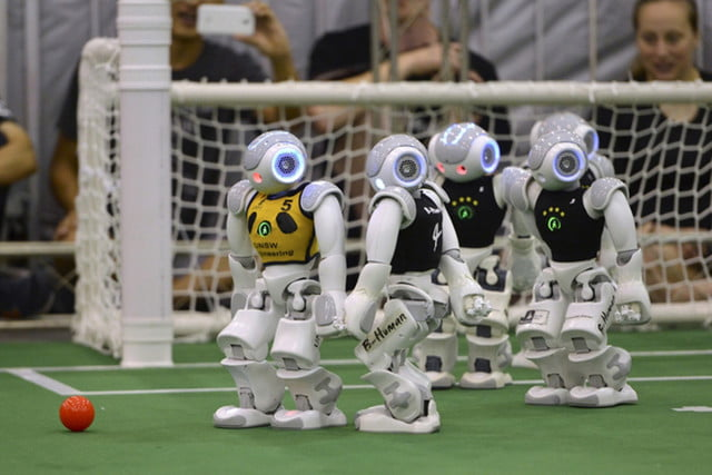 Robots Focused on a ball at Robocup in Japan