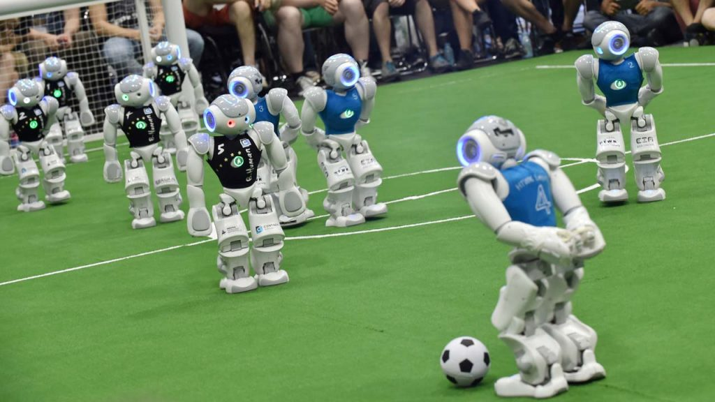 Robots-fight-for-the-ball-during-their-football-match-in-the-standard-platform-league-tournament-at-the-RoboCup-2017-in-Nagoya-Aichi-prefecture-on-July-30-2017-1024x576 Why Robotic Process Automation (RPA) is Taking Over Your Job