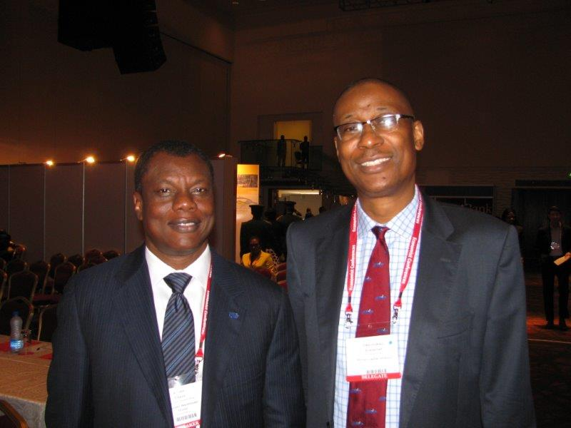 Founder and Entrepreneur-in-Residence at the Ausso Leadership Academy, Mr Austin Okere with the Minister of Industry, Trade and Investment, Dr Okechukwu Enelamahat The Economist Events' Nigeria Summit Conference, held in Lagos
