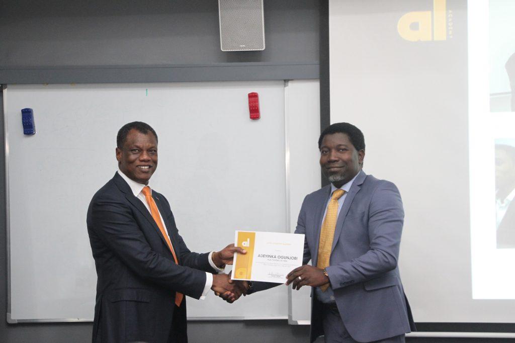 Mr Austin Okere, Entrepreneur-in-Residence, Ausso Leadership Academy (ALA) presenting a certificate to one of the delegates of the premier masterclass, Adeyinka Ogunjobi