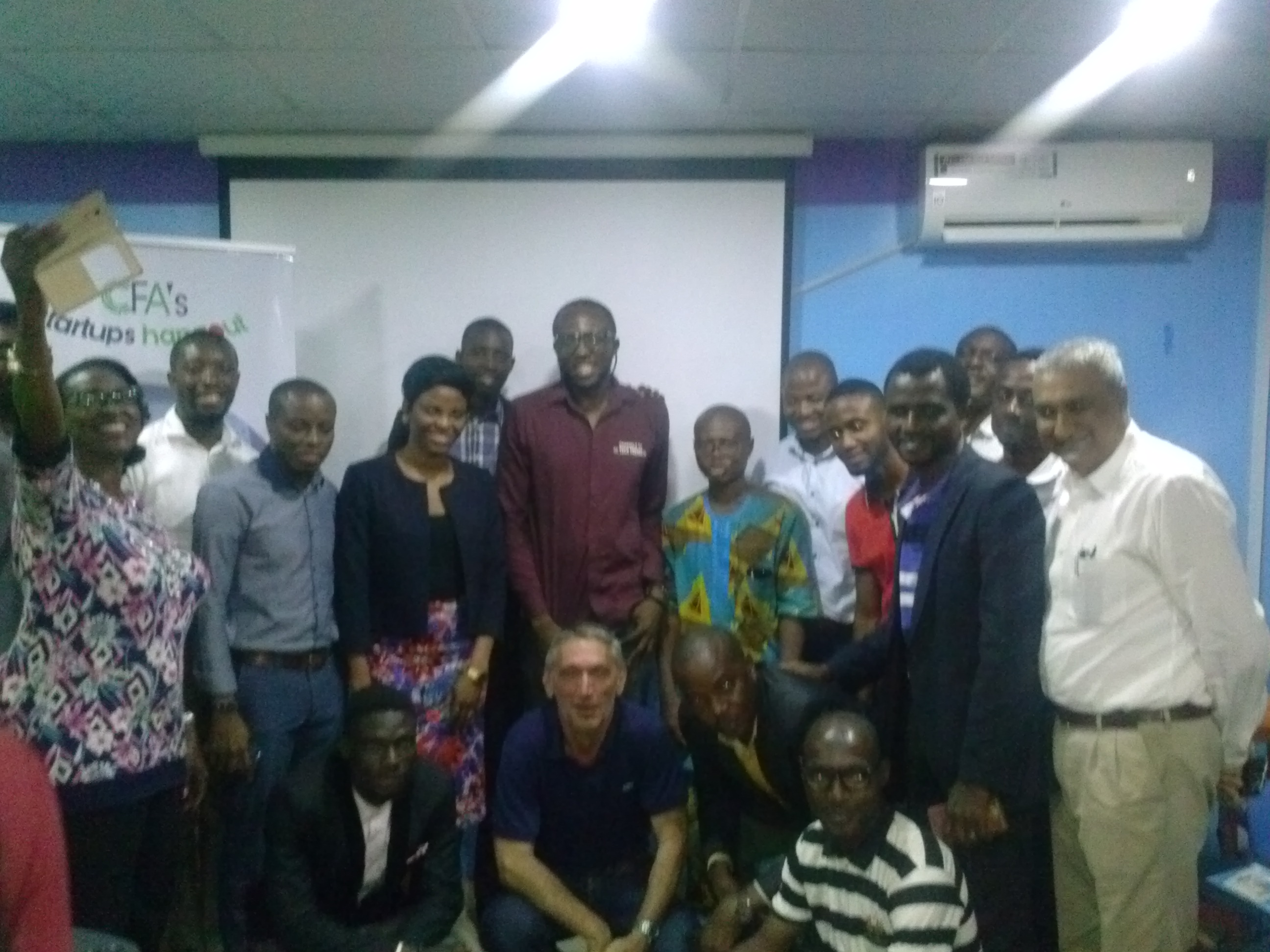 Jean-Marc, His Team, Founder CFAtech and some attendees.