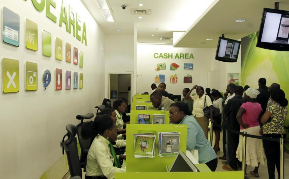Customers queue for mobile money transfers inside the Safaricom mobile phone care centre in Nairobi