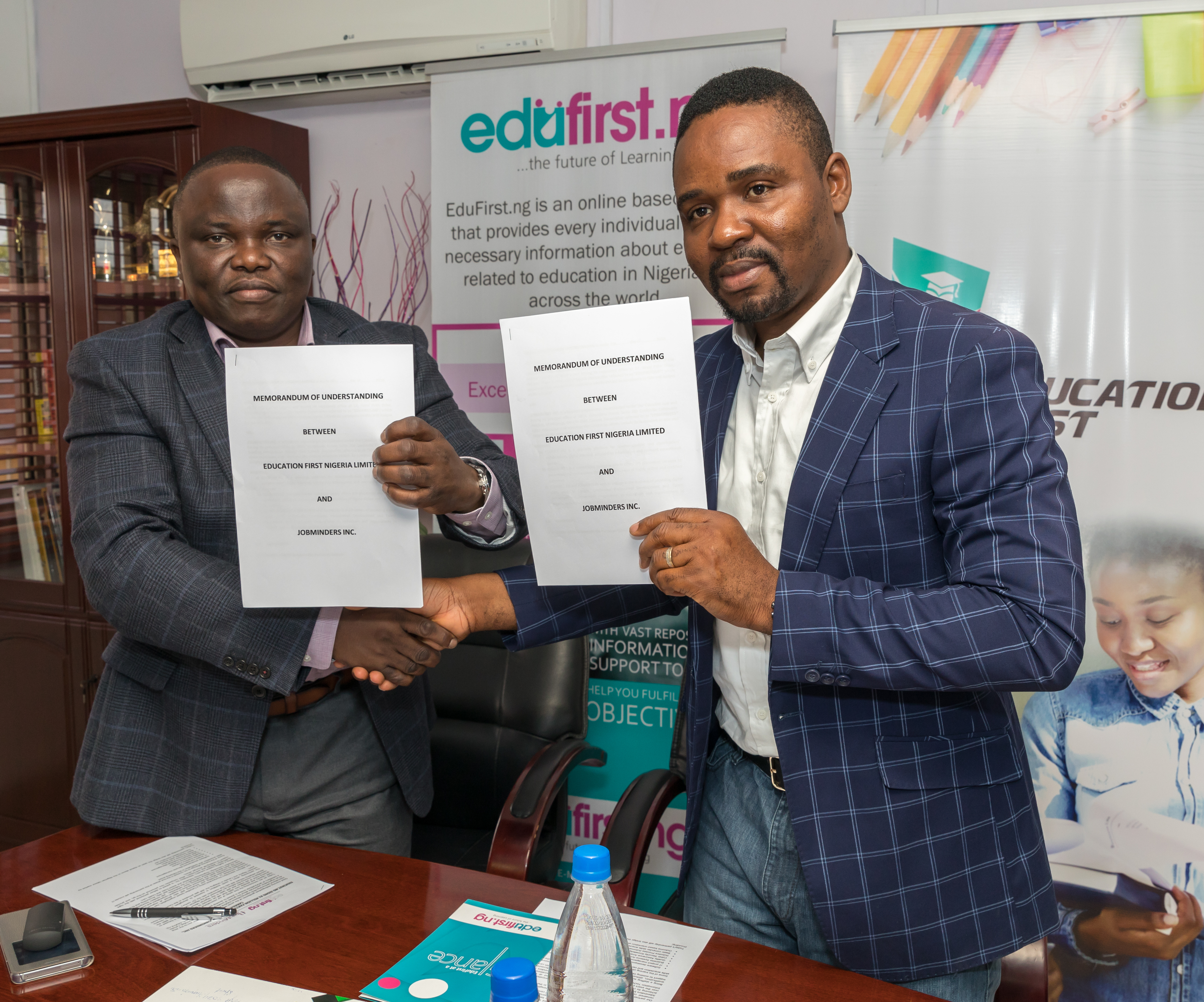 L-R: Vice-President, Job Minders Inc., Mr. Charles Osazuwa; CEO/Co-founder, Edufirst.ng, Mr. Moses Imayi signing the pact