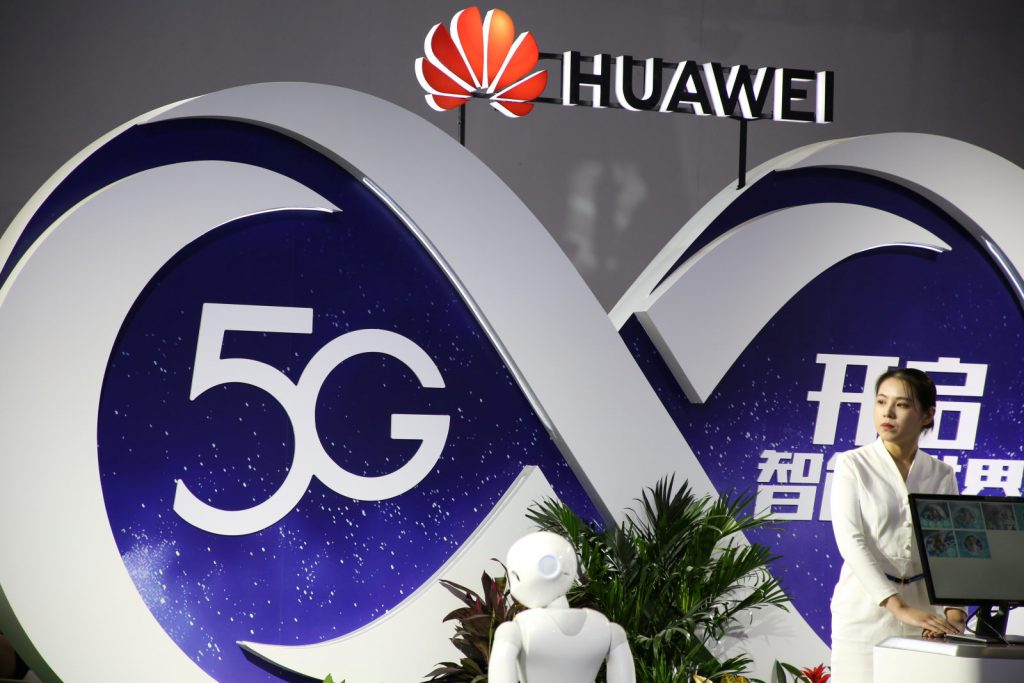 A Huawei booth featuring 5G technology in 2018 Samsung Appoints Roh Tae Moon as Head of Mobile Division as 5G Race Heats Up