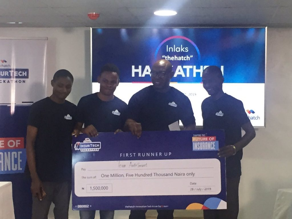 Femi Adeoti presenting prize to first runner-up at the insurance hackathon