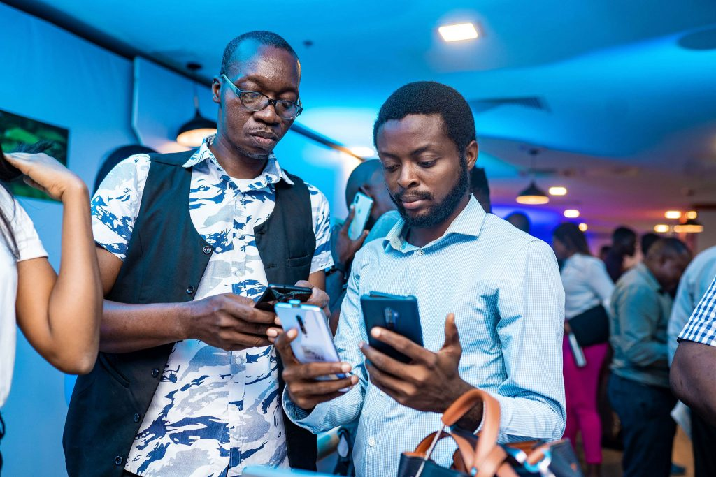 Guests examining the OPPO Reno2 device at the launch