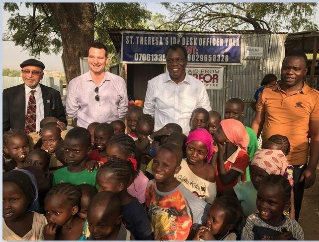 Ahmad Hosseini, Jon Eberly, Austin Okere, Rev Fr. Maurice Kwairanga with the Kids