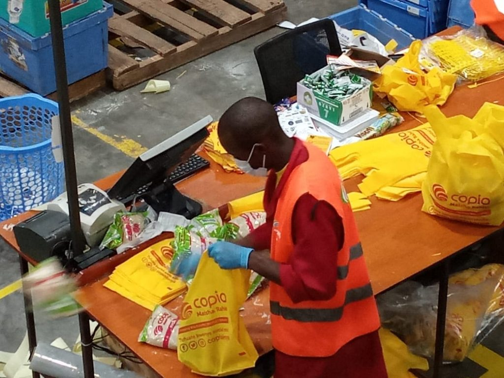 A CopiaKenya worker sorts items for delivery.