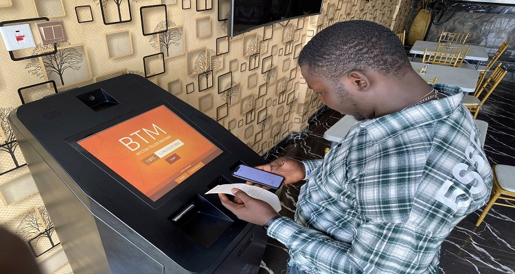 A bitcoin user checks the receipts after buying bitcoins with naira on Bitcoin Teller Machine in Lagos, Nigeria September 1, 2020. Picture taken September 1, 2020. REUTERS/Seun Sanni