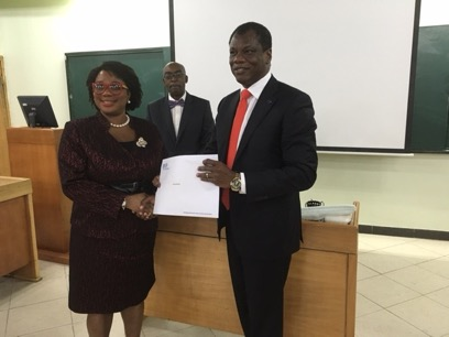 Justice Opeyemi Oke, representing the Chief Judge of Lagos State receiving the certificate of Participation